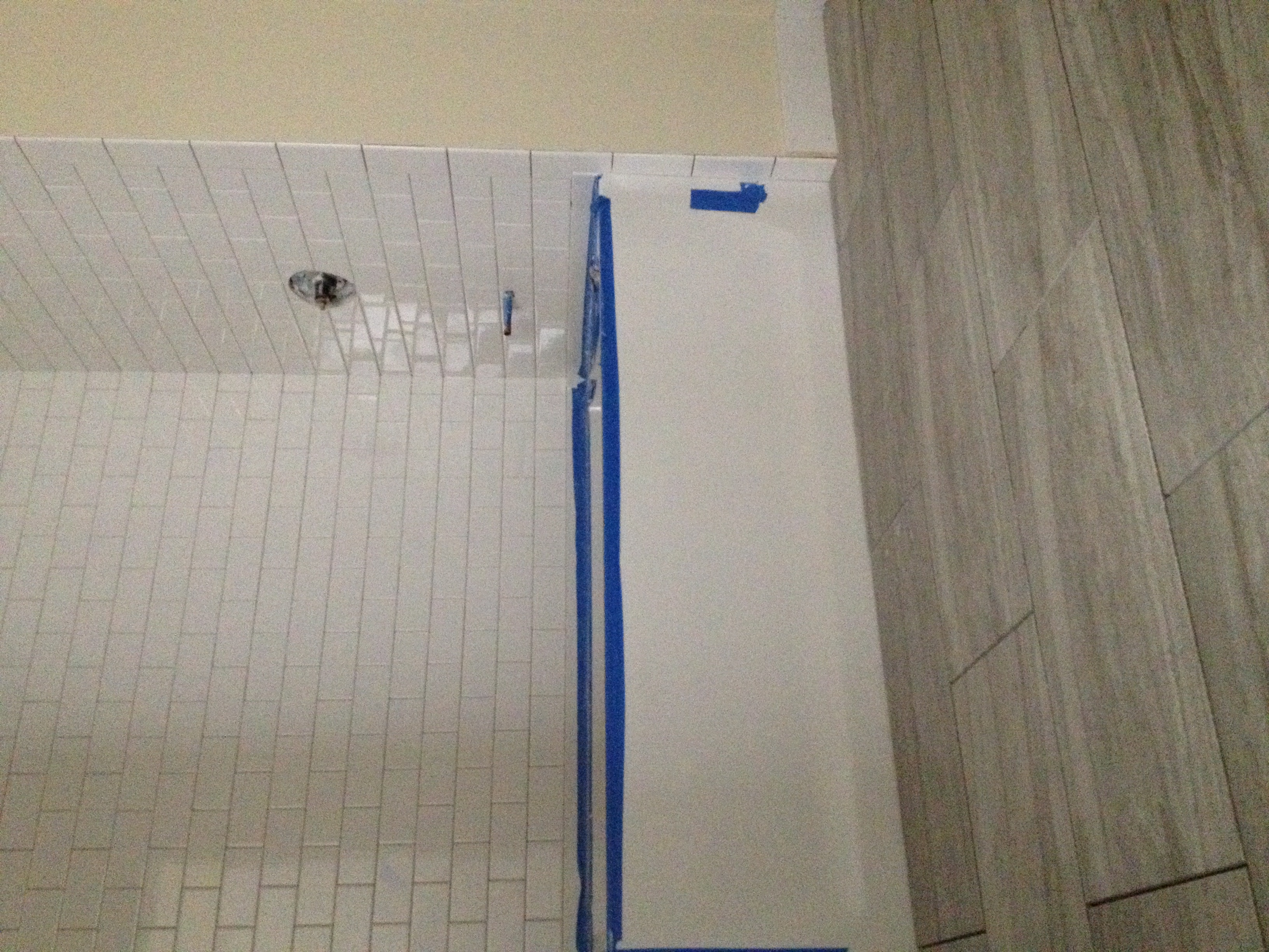 Tile surround and tile floors in Unit 101 bathroom.