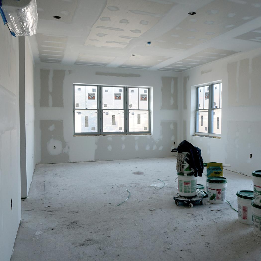 Drywall begins in Unit 303.
