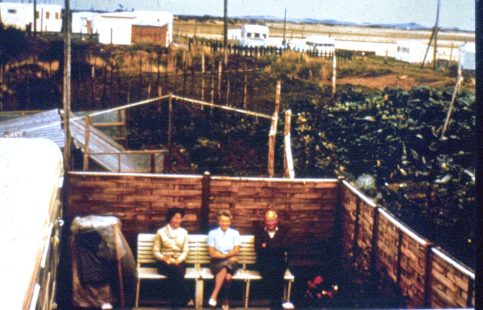 Dorothy, Eileen and Peter outside their original caravan