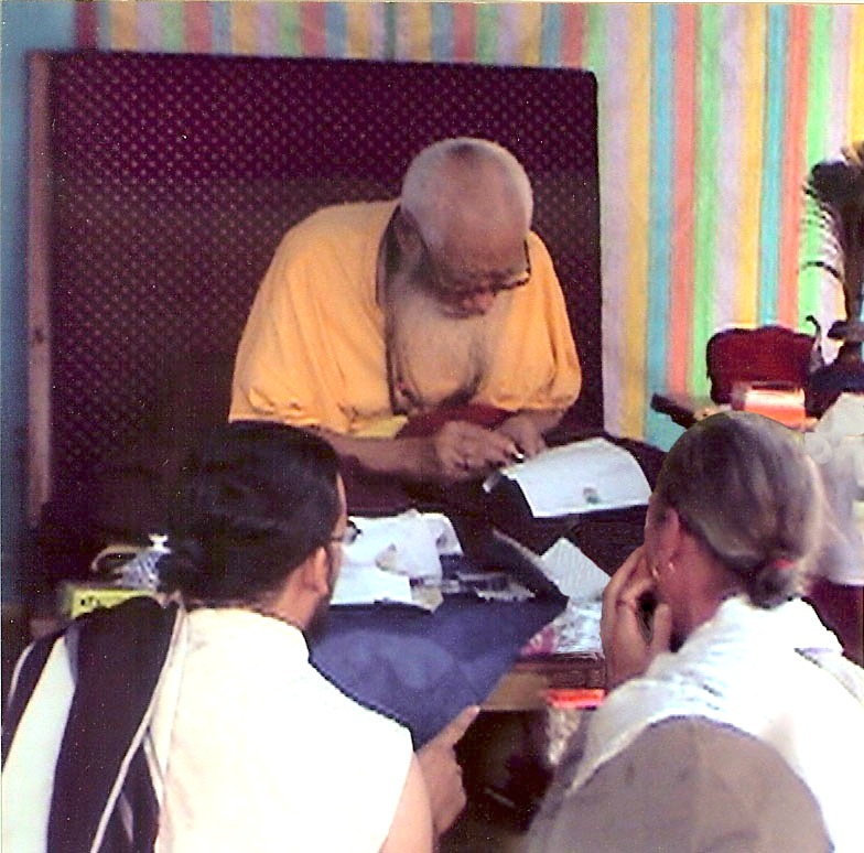 Kyabje Chatral Sangye Dorje Rinpoche writing with the new pen offered by Lama Padma Karma.