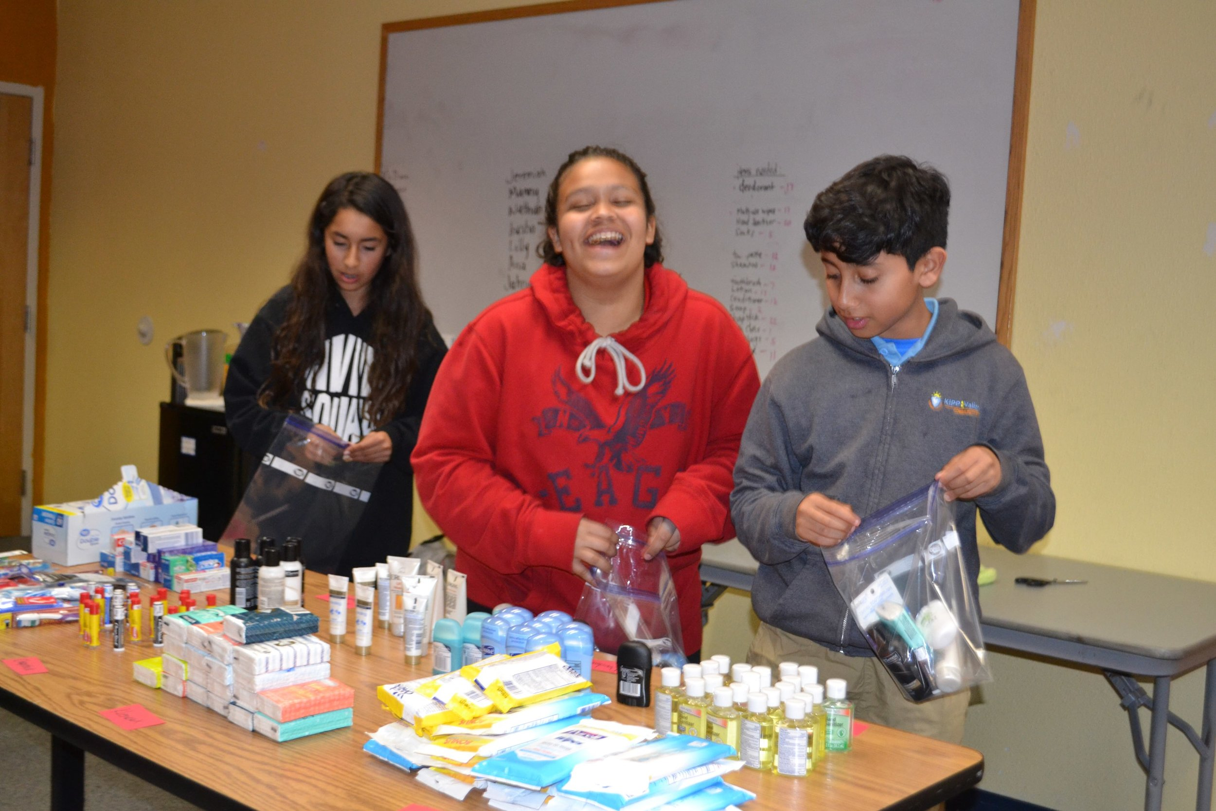 Building the Bags - Students fill the Blessing Bags with a variety of hygiene products.