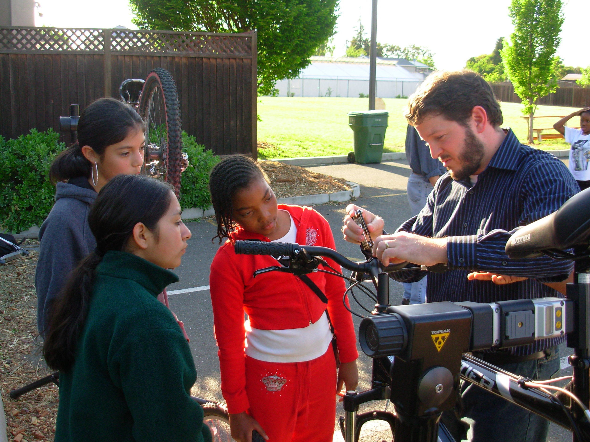 Where It Started - This photo of Justin teaching students how to work on a bike was taken almost 12 years ago when he first volunteered at BCM
