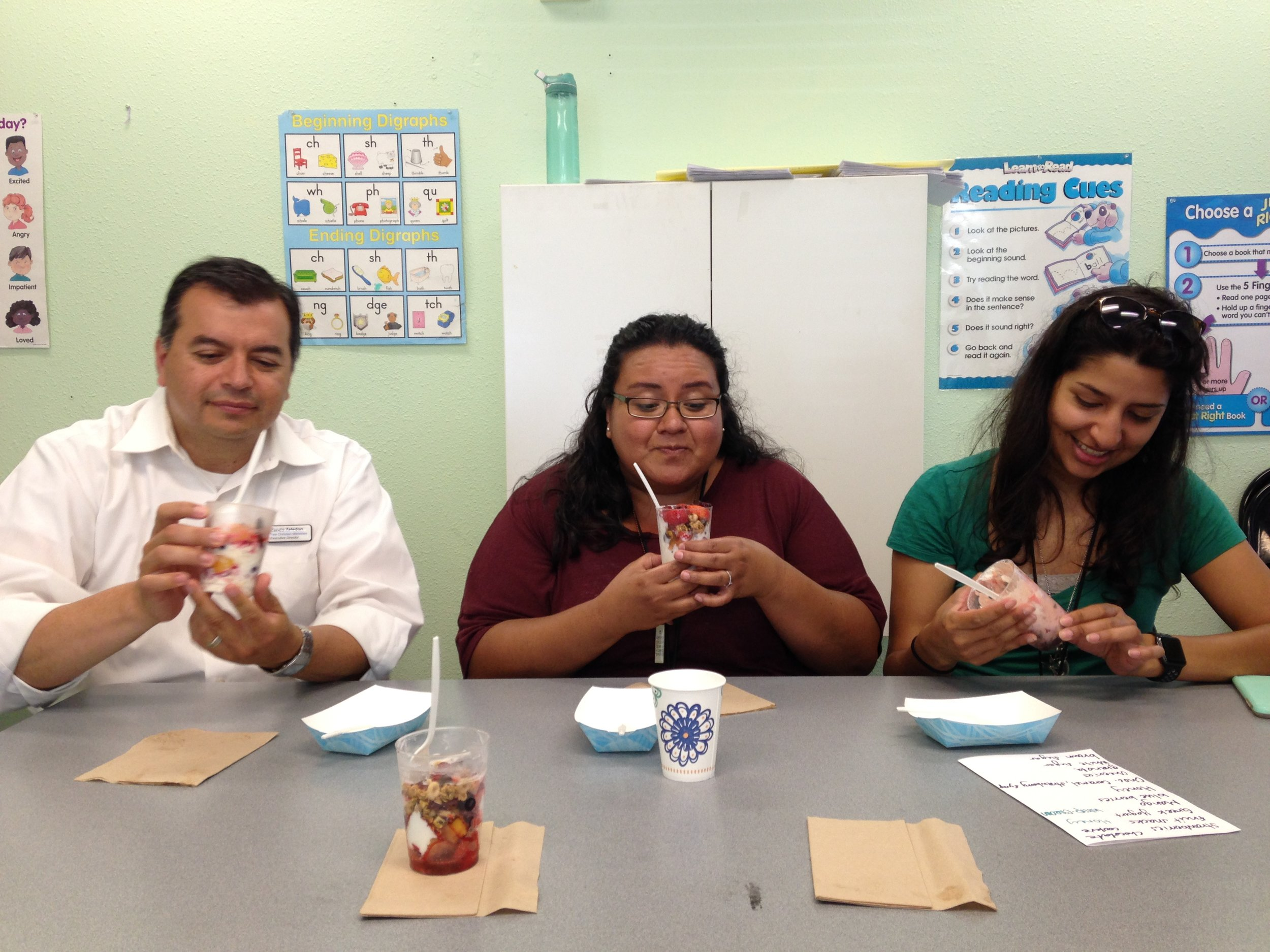 Taste Test! - In this photo taken in 2016, Cassie, Rolando, and Alyssa, one of our former staff, try yogurt parfaits made by our CREATE students during their Science of Cooking class.