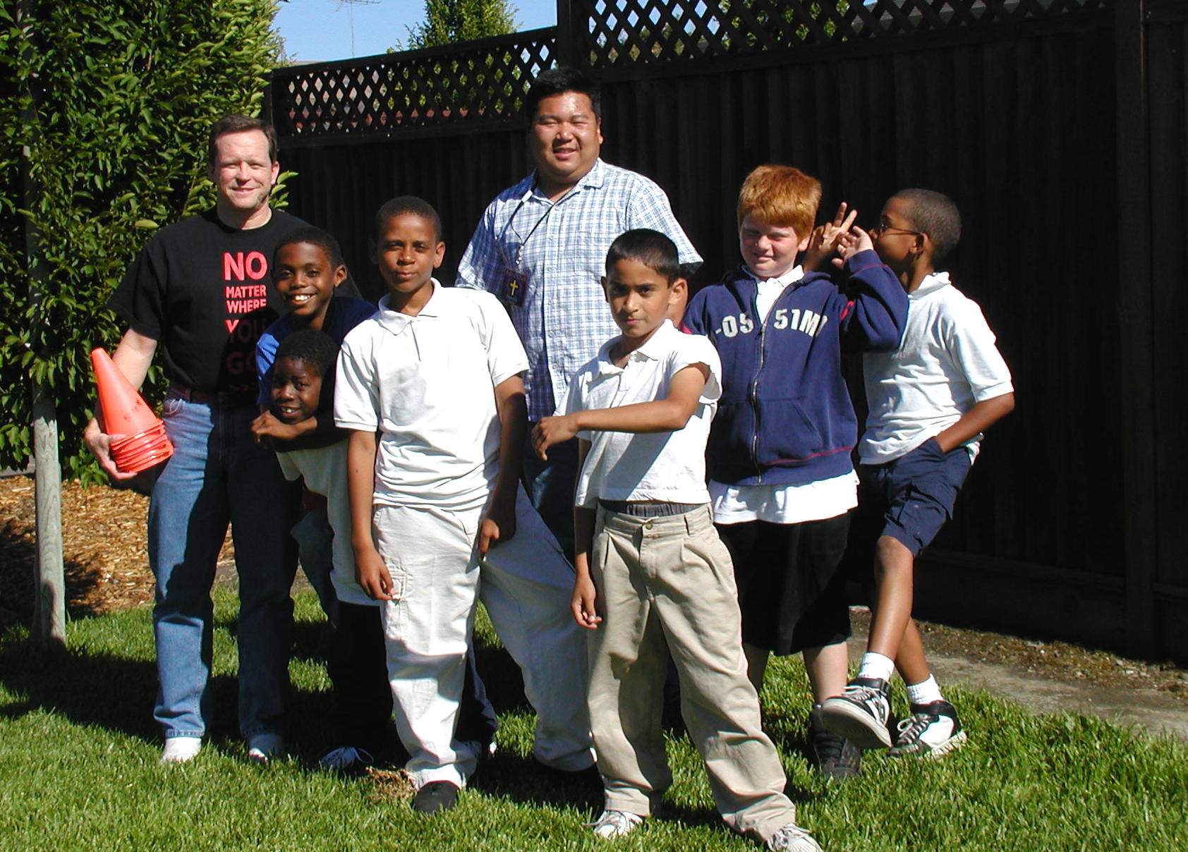 "Boys Club - Here Andrew and another staff member poses with the ""Boys Club"". (Picture taken in 2004)"