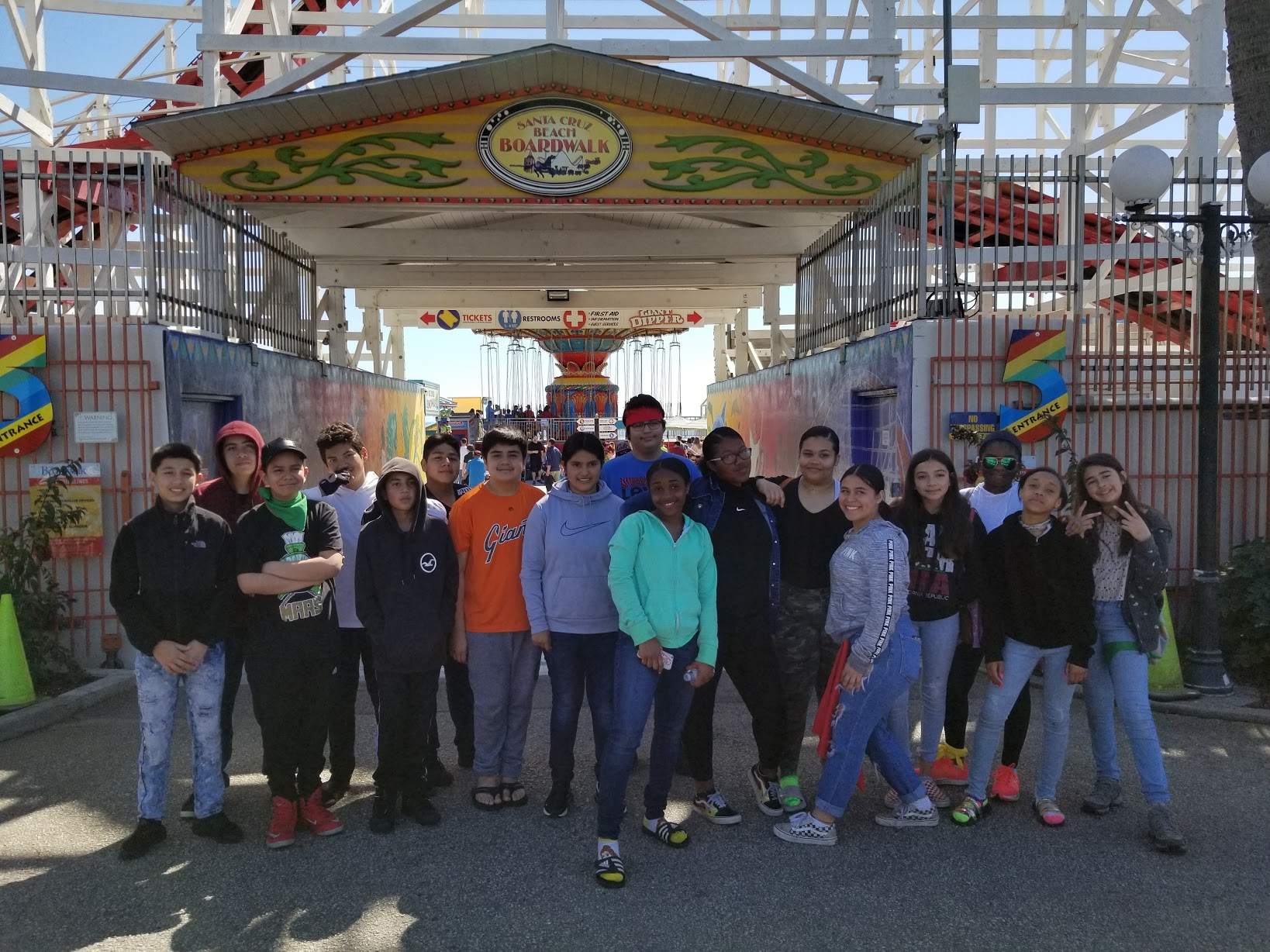 Streetworkz students pose for a picture in front of Santa Cruz Beach and Boardwalk.