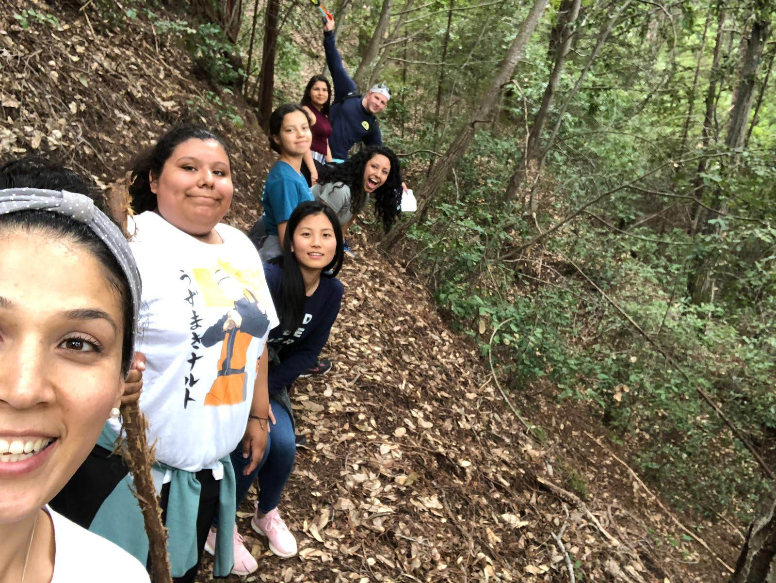 LiT students and volunteers pose for a picture during a hike.
