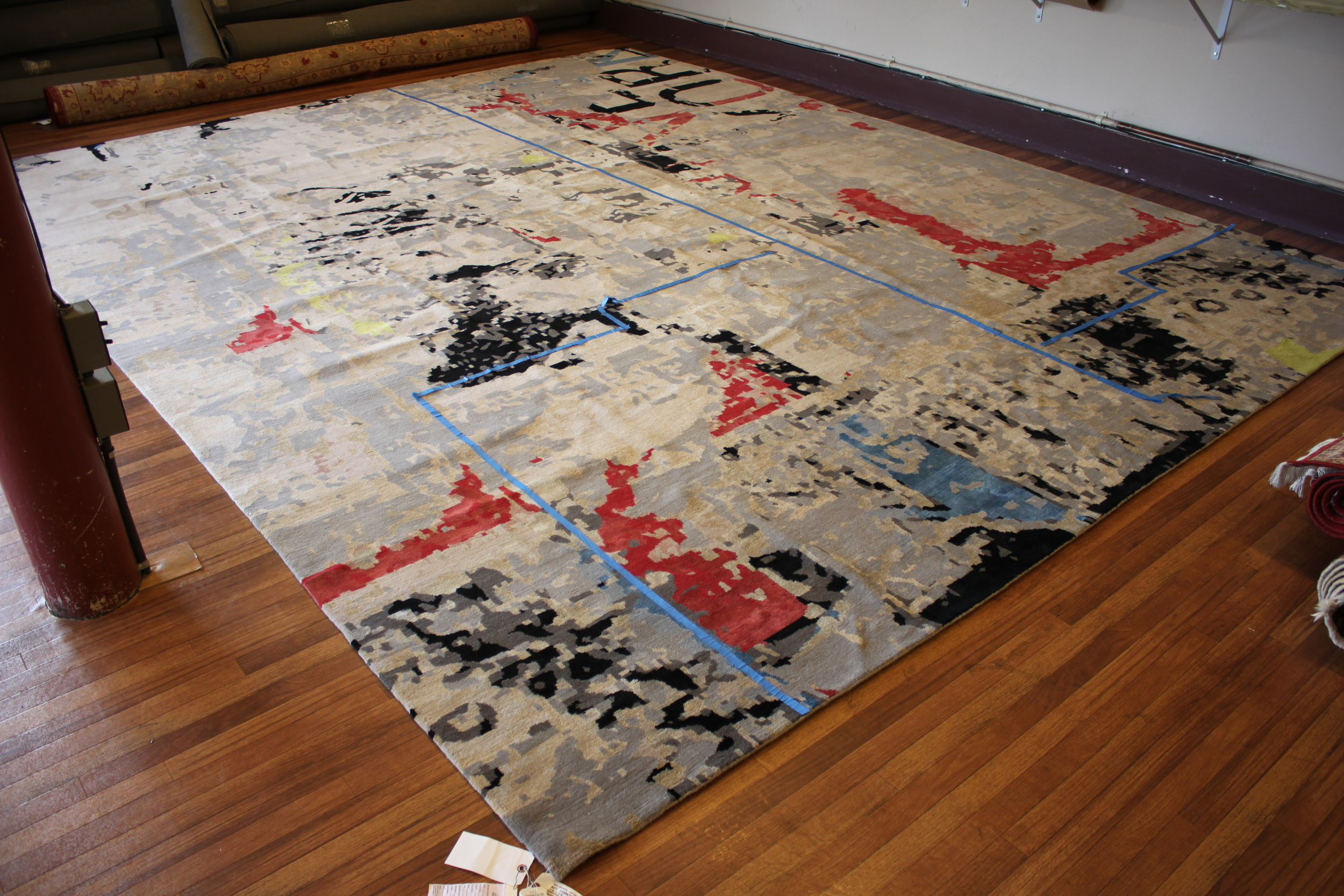 Hand made Tibetan rug to be cut to fit bathroom.