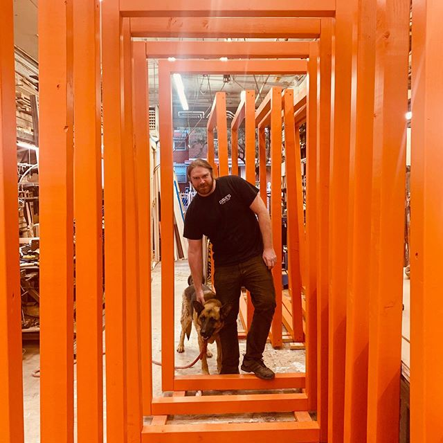 Dave and Scout pose in a tunnel of orange frames as we get ready for the install of Create and Cultivate (@createcultivate) brought to you by @mastercard and @wearebmf !! More pics coming soon 👀 #mastercard #wearebmf #createcultivatenyc #dog #shopdog #orange . . . . #setsandeffects #sets #setdesign #setdesigner #setconstruction #designandbuild #setlife #fabrication #setbuilding #artdepartment #artdirection #props #scenicdesign #cncrouter #lasercut #signage #eventdesign #experiential #behindthescenes #brooklyn