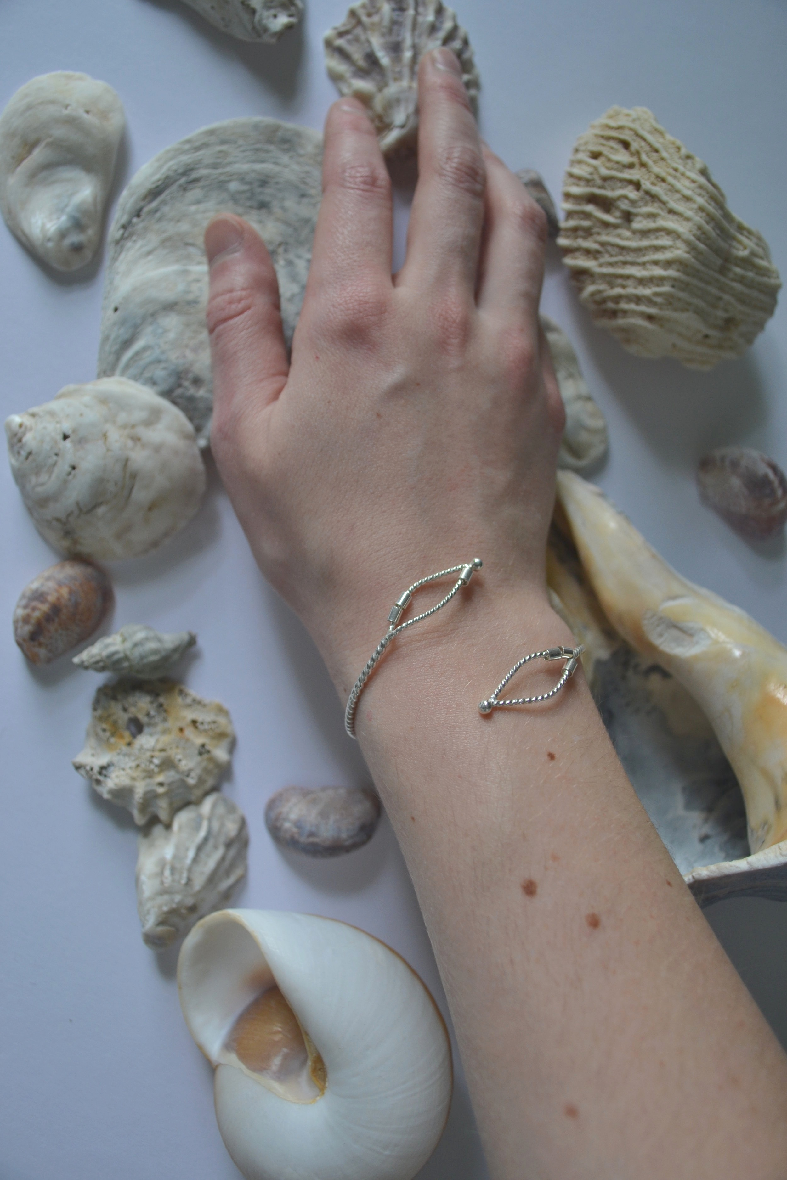 Bracelets of the Burnished Collection -