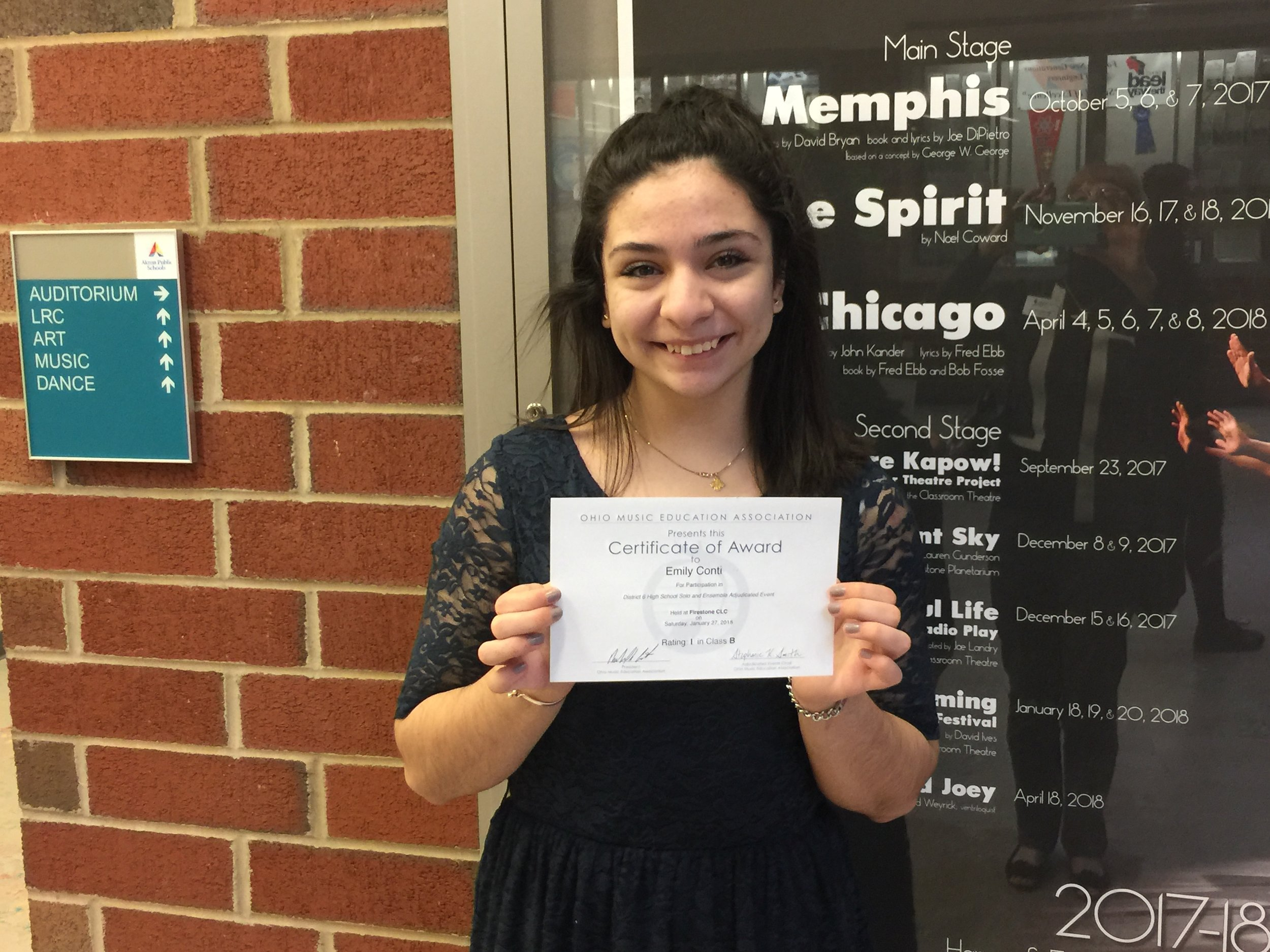 Emily Conti  poses with her certificate after receiving a Superior rating for her vocal solo.