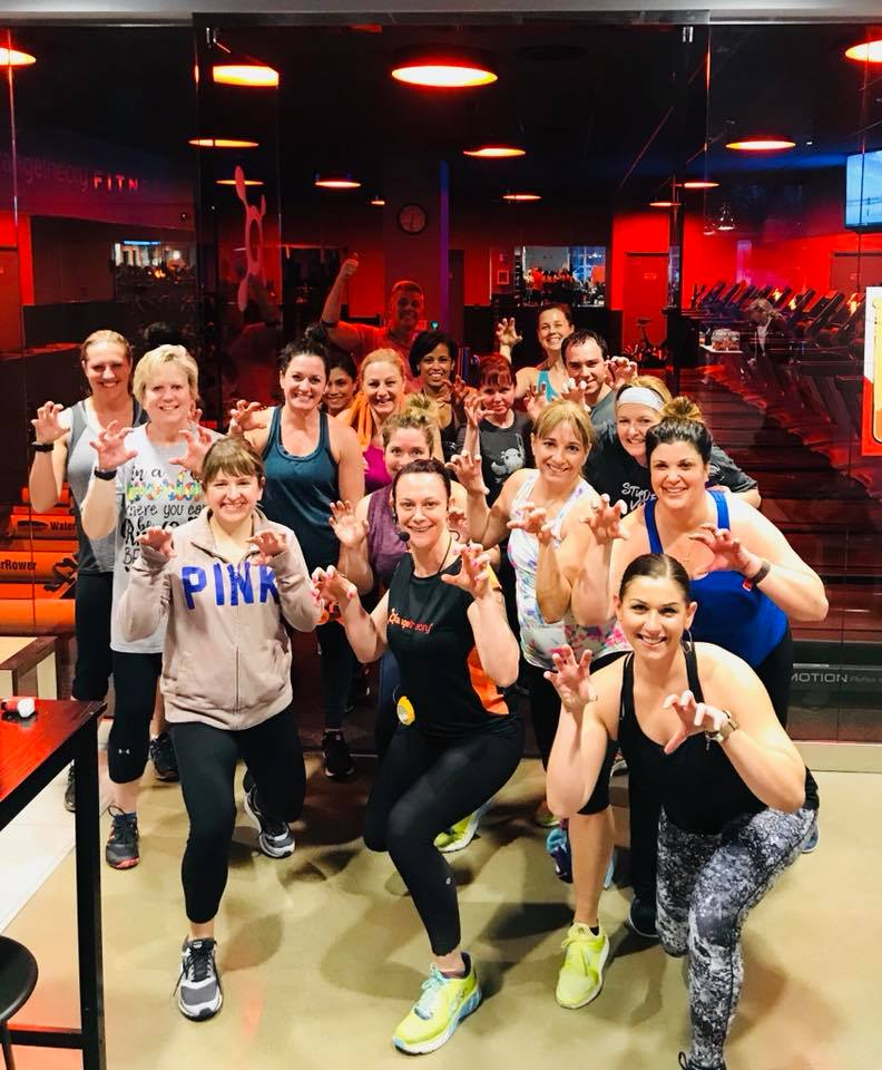 Mary Laske Bell  (front row, center) leads a class at Orangetheory Fitness.