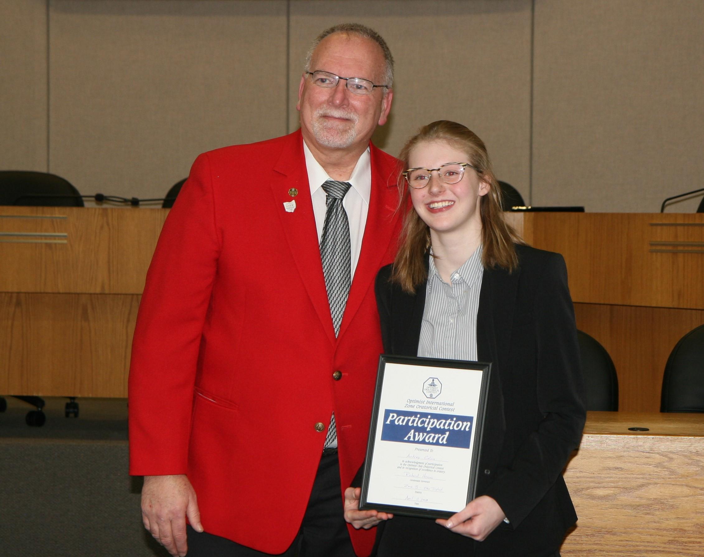 Optimist host  Tom Breno  congratulates third-place winner  Audrey Calvin .