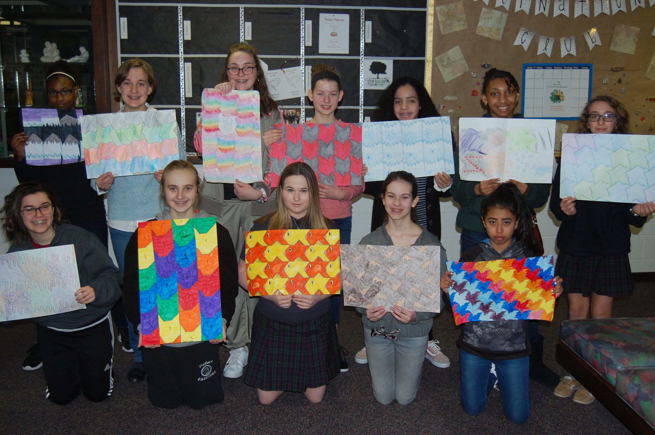 Elms Middle School students display their tessellation posters.