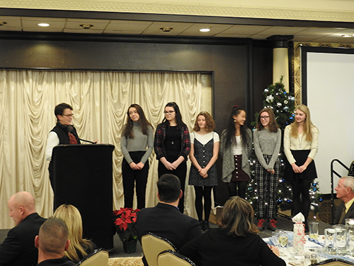 Members of the Elms Social Action Club accept the Bishop Anthony M. Pilla Leadership Award.