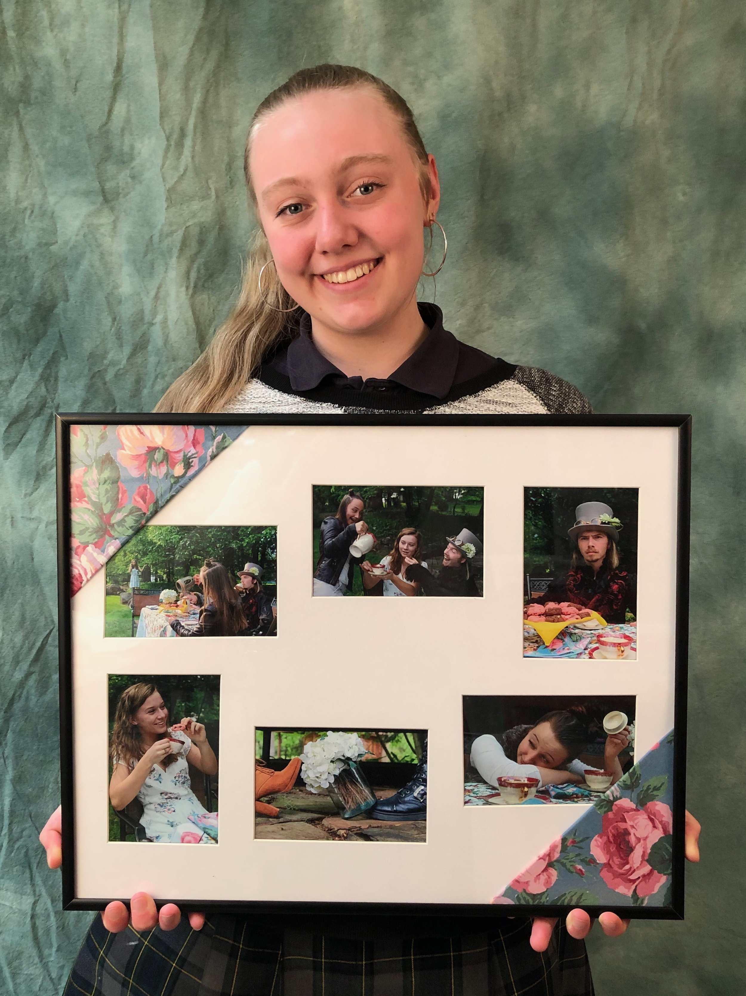 Marina Hershberger '19 and her artwork depicting the Mad Tea Party.