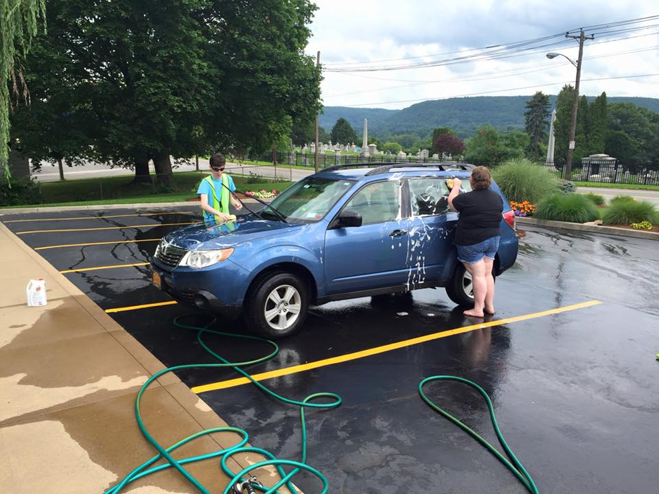 SPARE Members participate in a car wash fundraiser at Hatala Orthodontics