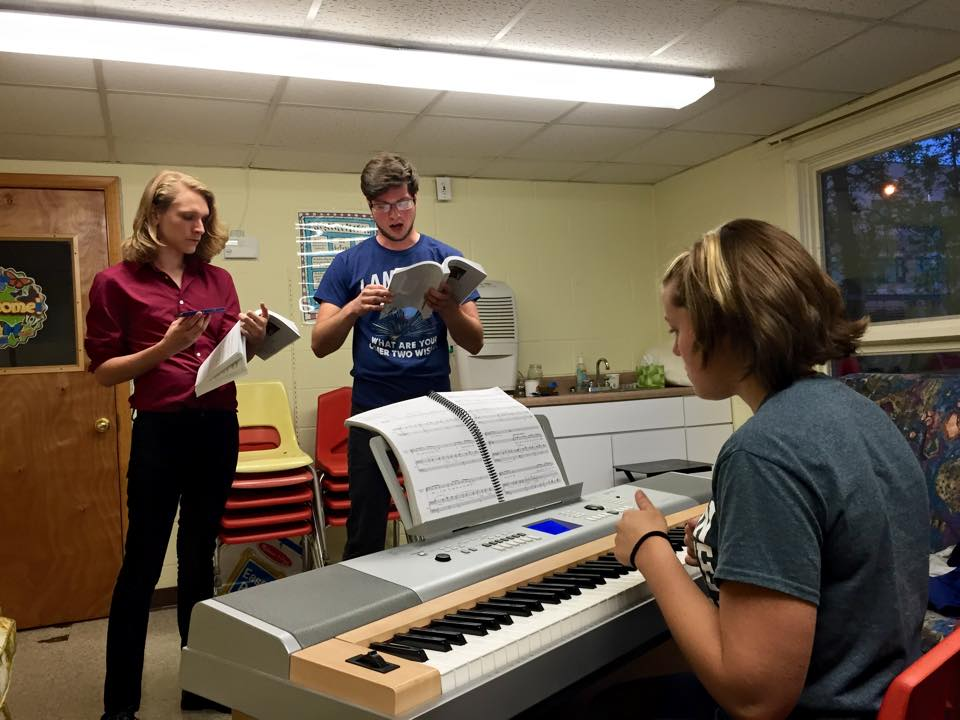 into the woods  Assistant Music Director Megan Santa Croce helps cast MEMBERS Evan Walley and Matt Vegiard in rehearsal