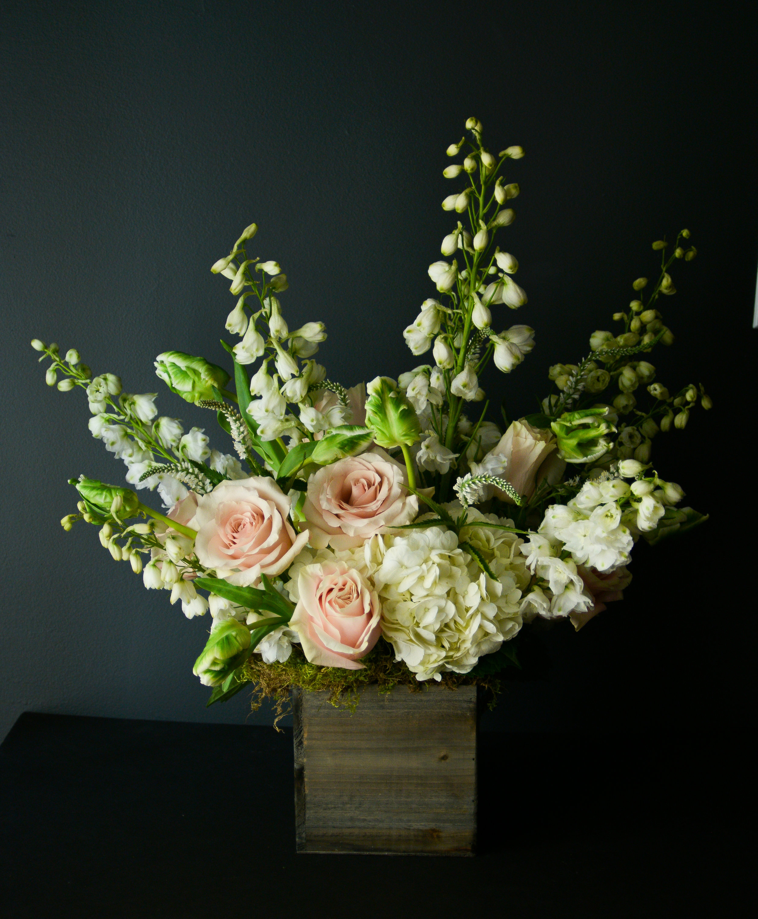 $200 Arrangement   Fills the space, draws the eye, shows off all its curves and edges. Makes a statement! More expensive florals can be used for an extra special feel. Perfect for corporate gifts, funerals, and other special occasions.