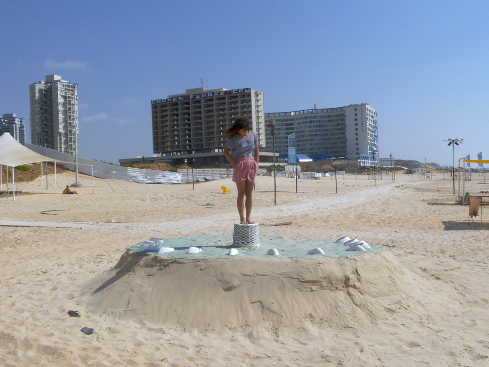 """Guy Ben-Ari and Leah Wolff,  Time Loops - Human Sundial , 2011, Sand, plaster and acrylic paint, 5 x 14 x 14 ft  Analemmatic sundial built collaboratively with Guy Ben-Ari. This project was commissioned by the city of Bat Yam, Israel during the summer of 2011.   Artists and collaborators Guy Ben-Ari and Leah Wolff were invited to participate in Ocean Breeze, a public sculpture project in the city of Bat Yam, Israel. The resulting collaborative piece titled """"TimeLoops"""" referred to the ideas of Gilles Deleuze about repetition as part of the human experience, and the cyclical nature of our daily habits. The installation was meant to be used by the public as a human sundial, when the viewer standing in the center of the installation could tell thetimeaccording to the location of their shadow on the ground.  The show was be open to the public from AugustthroughSeptember 2011."""