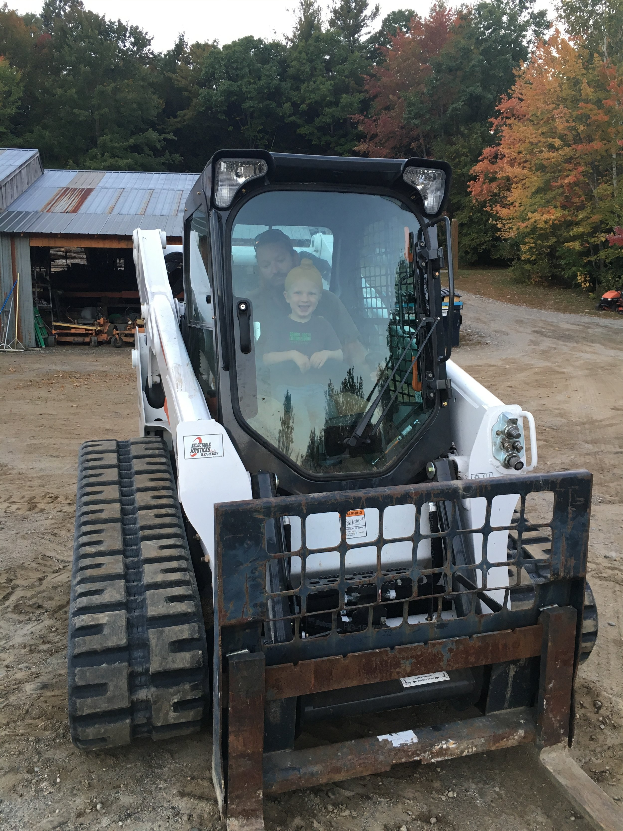 skid steer in work yard