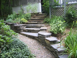 Montague steps and retaining wall. One of our early jobs. Photo links to gallery of various landscaping jobs