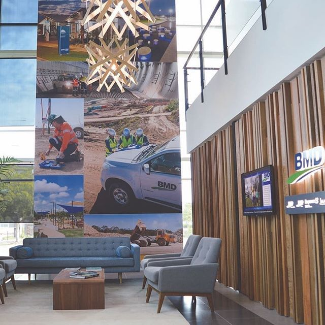 Throwback Thursday to March 2016! We #transformed the space at BMD's office at the Port of Brisbane with oversized graphics,natural materials a fresh colour palette and clean signage solutions. The staff love working here – check out their awesome break room. We can revitalise your office or shop today – full project management!  #officefitouts #interiordesign #signs #signage #officelooks #breakroom #chilloutzone @BMD #corporatelife #officemakeover #bestoffice