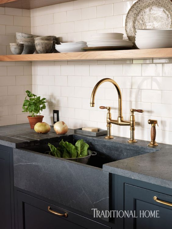 traditional home dark countertops dark cabinets and sink.jpg