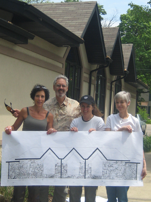 Mike is pictured with the Mural Committee before work begins.