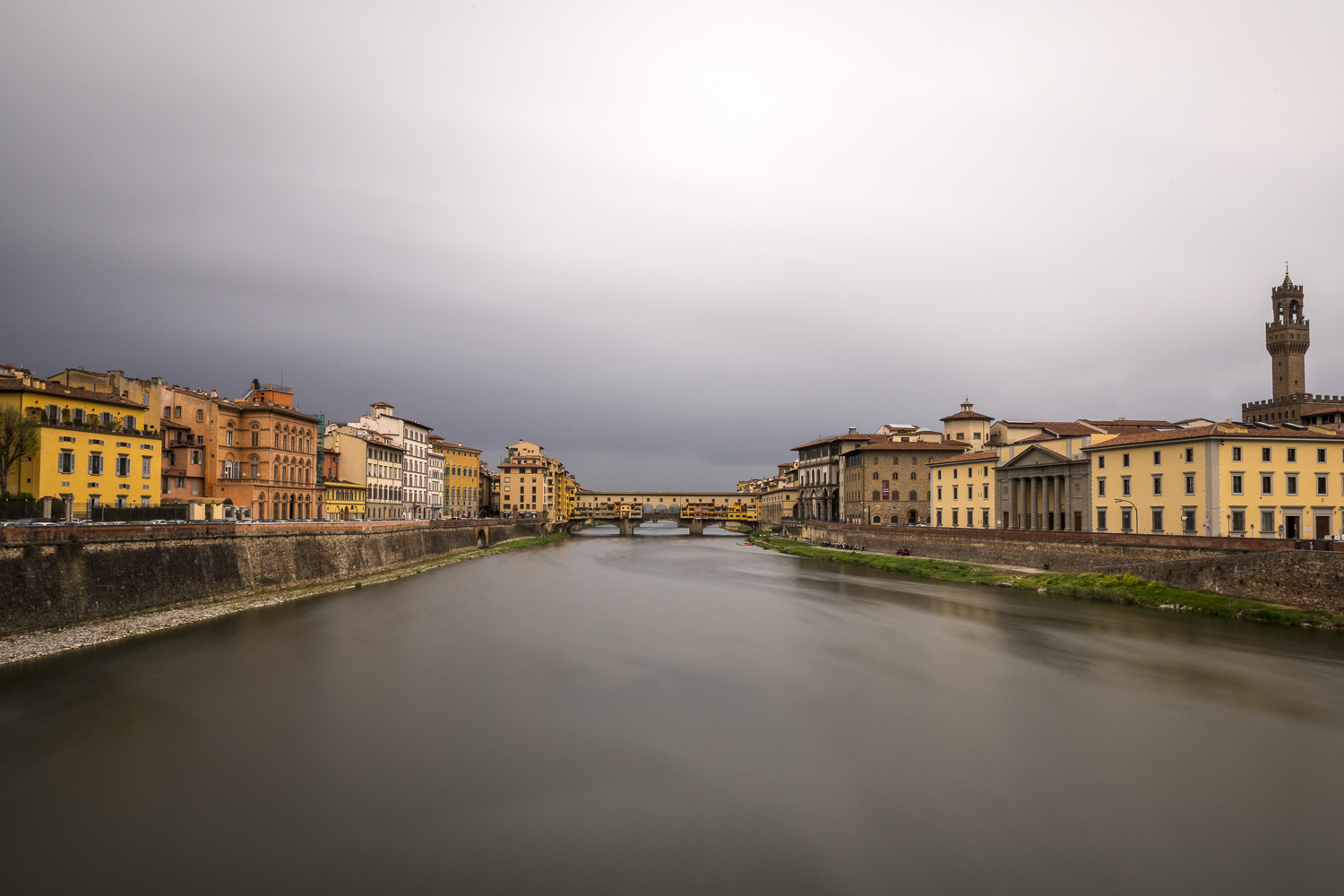 The Arno River and Ponte Vecchio during a moody sunset.