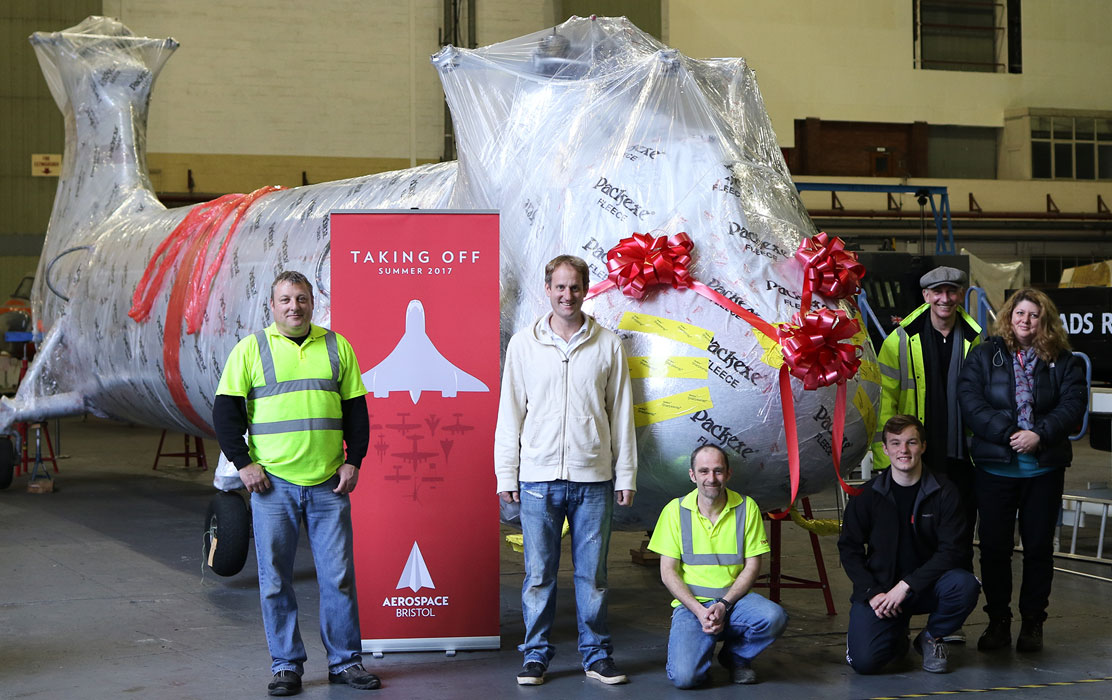 Linda Coode, Aerospace Bristol Collections Manager (far right) joins   Andrew Orchard, CEO of Packexe (second from right) to celebrate a good job well done!