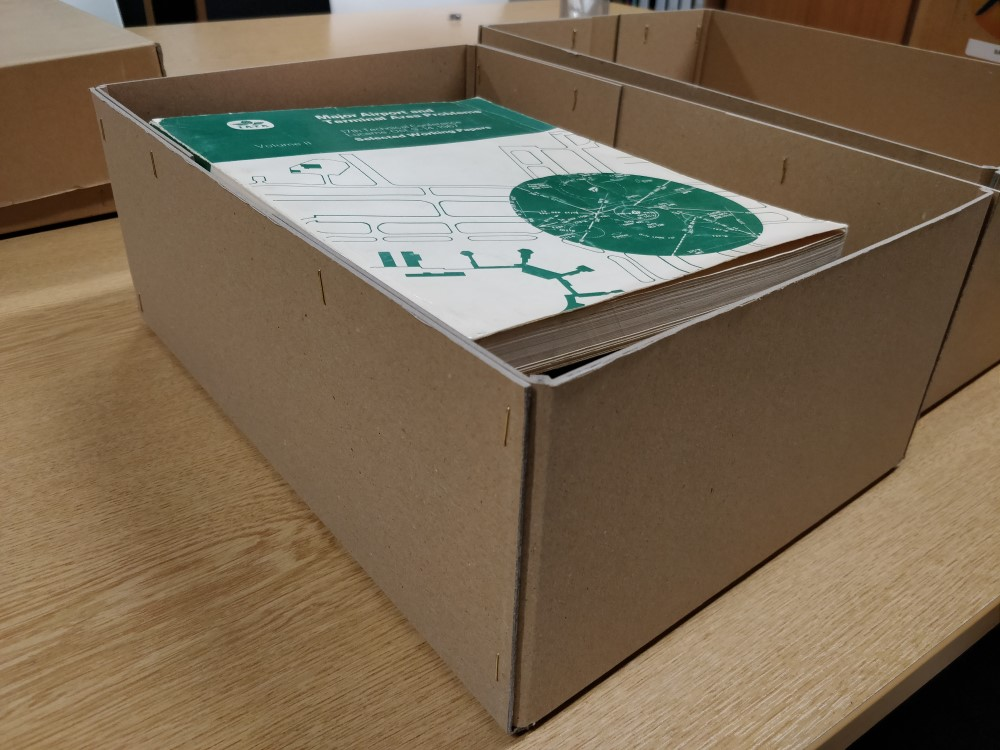 Low-acid surroundings should help preserve the documents in their current conditions, the lid should help keep out anything we wouldn't want in there, and then the box will be stored in the sealed and environmentally controlled archive store. Nice and secure!