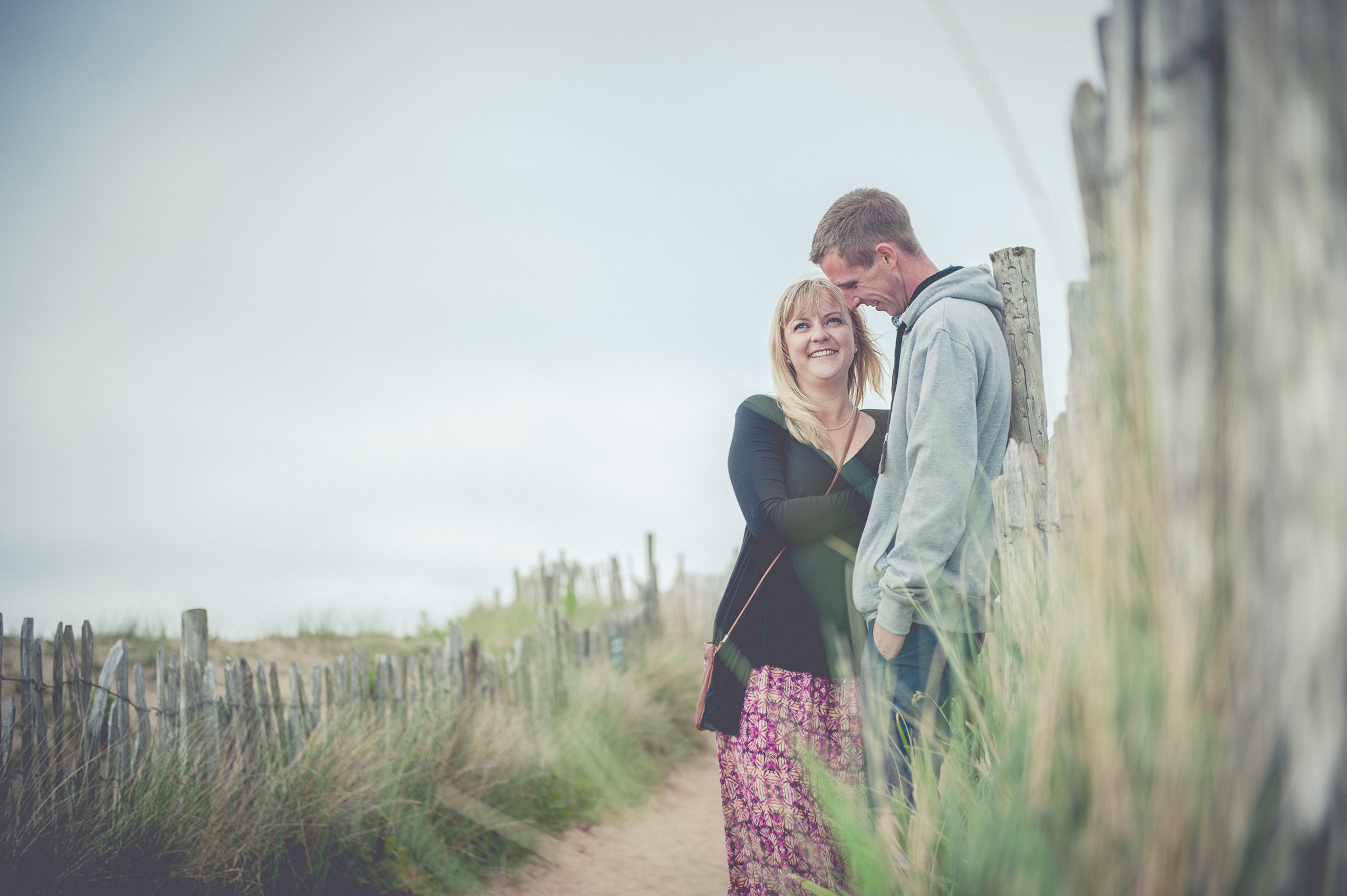 Engagement session photo of love taken at Bantham Beach, Devon.