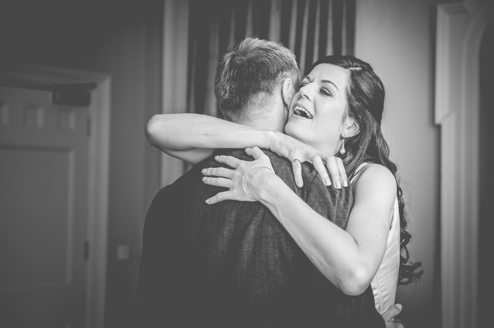 Bride embraces her groom