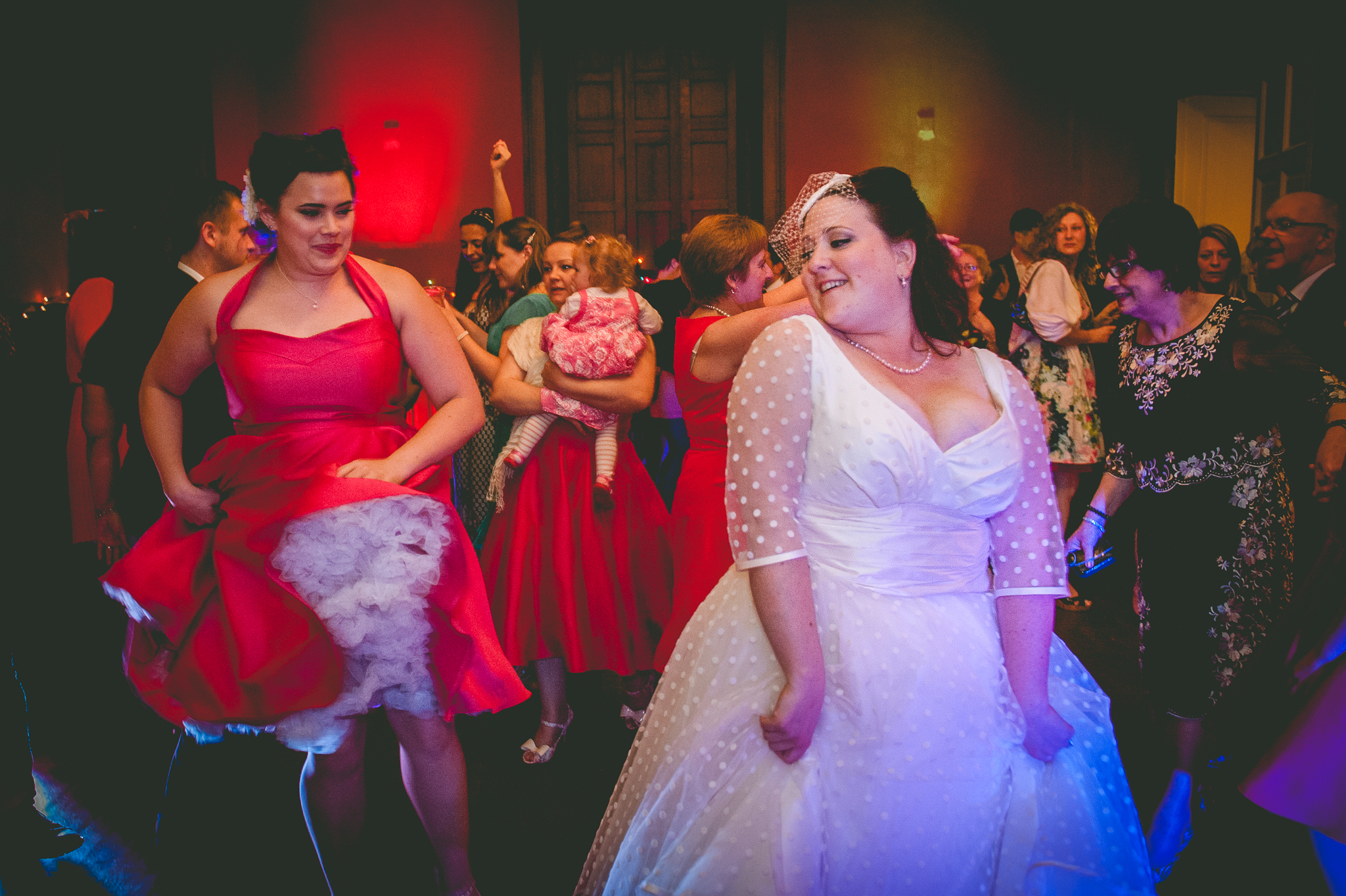 dancing bride and bridesmaids