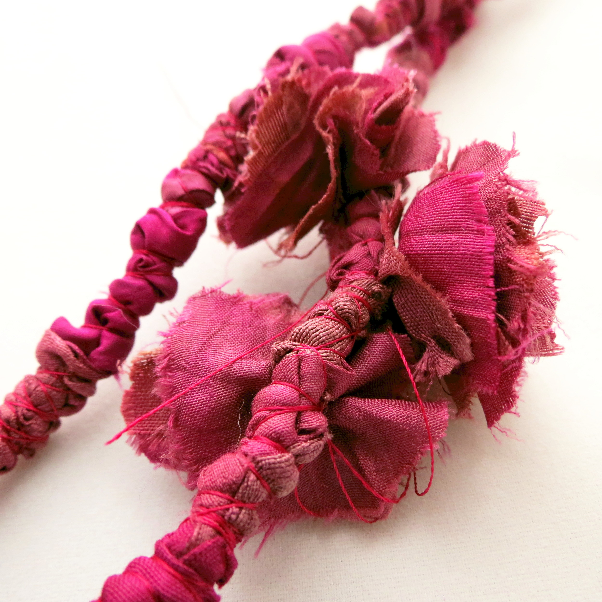 Maala – Francesca Cecchini (2014), necklace (detail) // Materials: repurposed sari silk, silk thread.