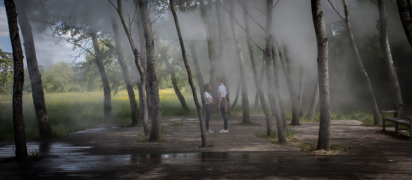 This couple was caught by surprise when the mist sprinklers were turned on by a timer. Luckily they took it as a romantic moment.