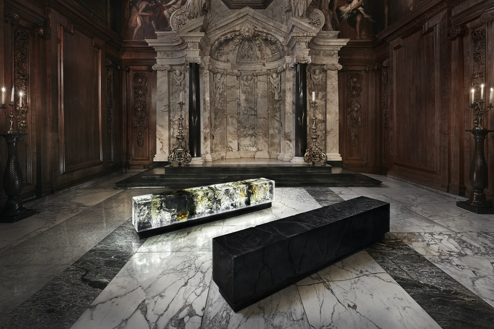 For Counterpart, this special commission for the permanent collection at Chatsworth, two blocks sit together but materially are diametrically apart. The dark block is made from coal, a reference to mineral rights held by the Devonshire family, while the glowing transparent resin block directly references crystals in the mineral collection at Chatsworth, begun by Georgiana, Duchess of Devonshire in the 18th Century.  The two blocks also relate to the material relationship between the artworks on display throughout the house and the plinths upon which they sit, challenging the perceived hierarchy between art, nature and function.  Throughout the house a fascinating interplay between nature and artifice is evident everywhere from a beautifully veined stone lintel to an intricately carved wooden frame bordering a trompe l'oeils depiction of nature. Each is magnificent in its own right. At times the natural splendour of a marble plinth will completely eclipse the sculpture it was built to support, bringing into question the true value of materials compared to what is made from them. Counterpart celebrates this blurring of nature, craft and art through the mix of natural and synthetic materials, and production process that are as much laboriously hand crafted as they are influenced by chance.  Materials Coal; resin; tar; steel; wood; jesmonite; acrylic  Approximate Dimensions  Each block: H: 450 mm - W: 350 mm - L: 2200 mm  __  PhotographyCourtesy of Chatsworth House Trust/ text courtesy Tom Price   more from Tom Price here