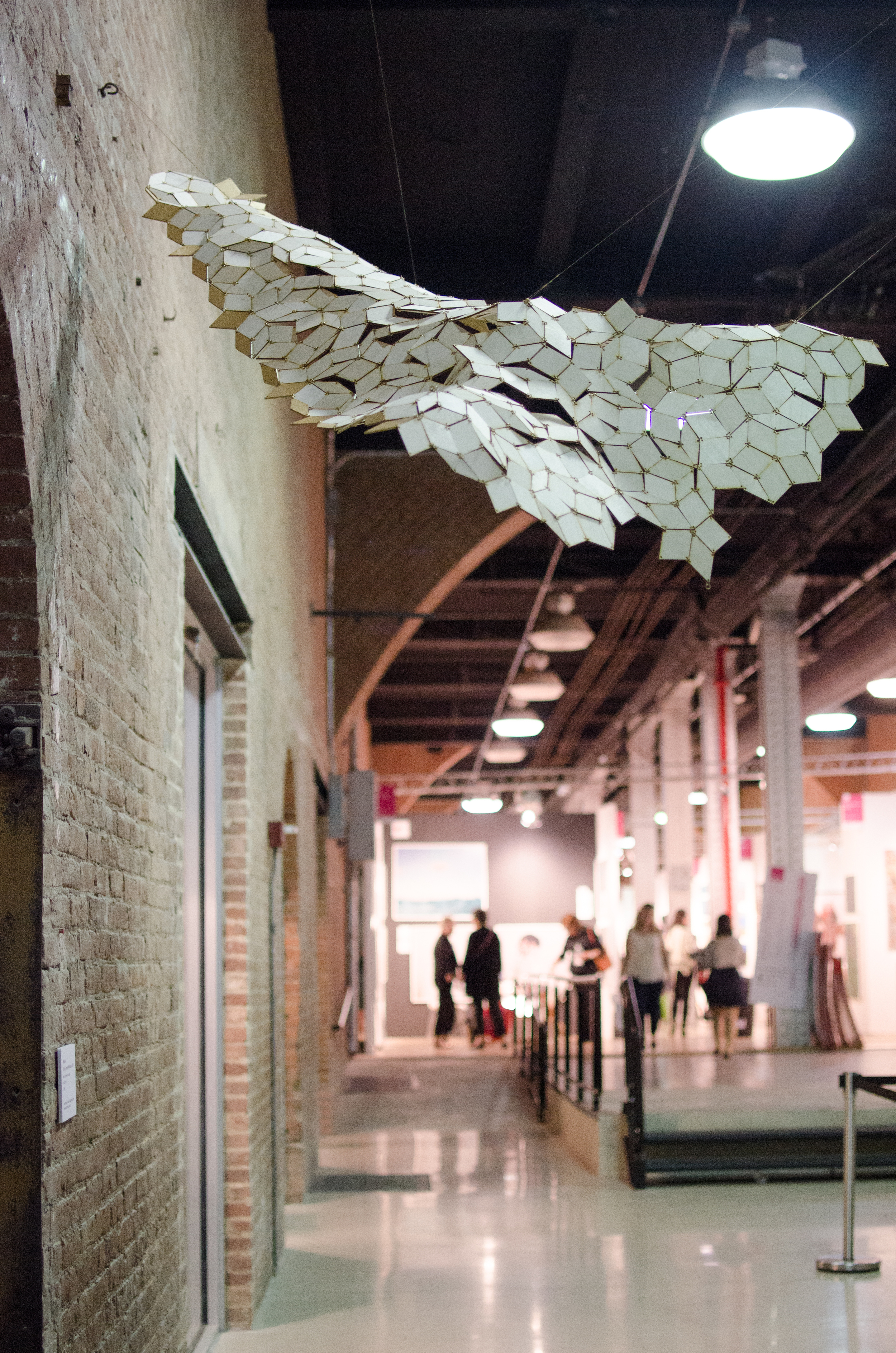 Floating Penrose Rhombuses  at the Affordable Art Fair, September 2014. The gold tiles at the right and left edges of the piece highlight the locations that the tiling loses its mirror symmetry. Photo: Talya Stein