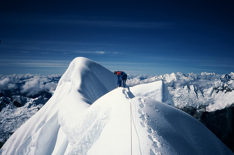 Traversing the precarious summit ridge of Alpamayo, Peru