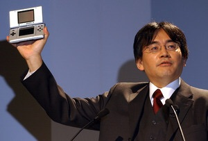 Iwata showing off the original Nintendo DS