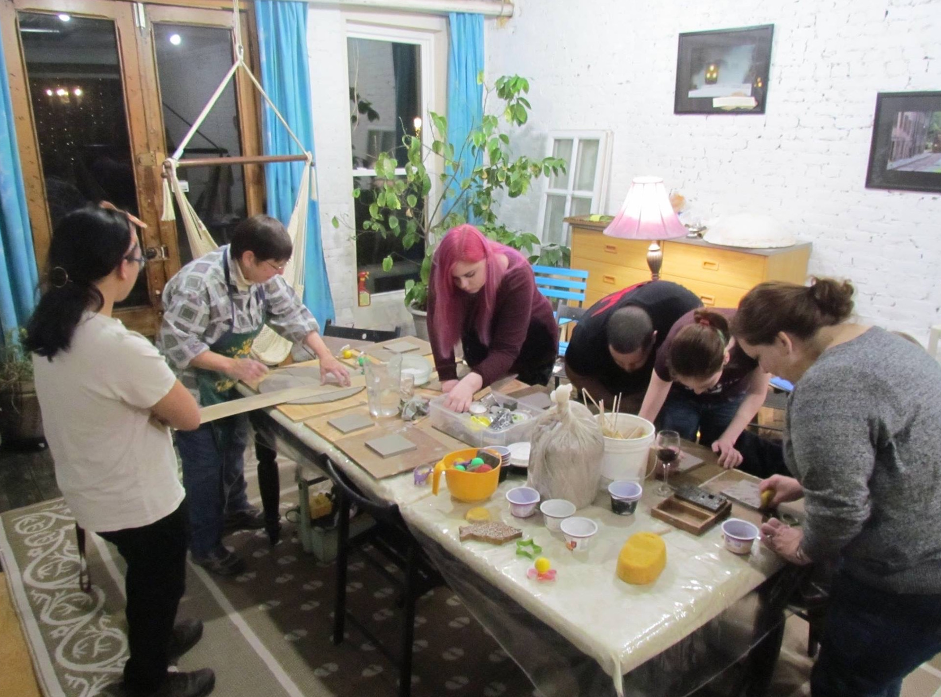 Making clay tiles in the studio during Arts on Main