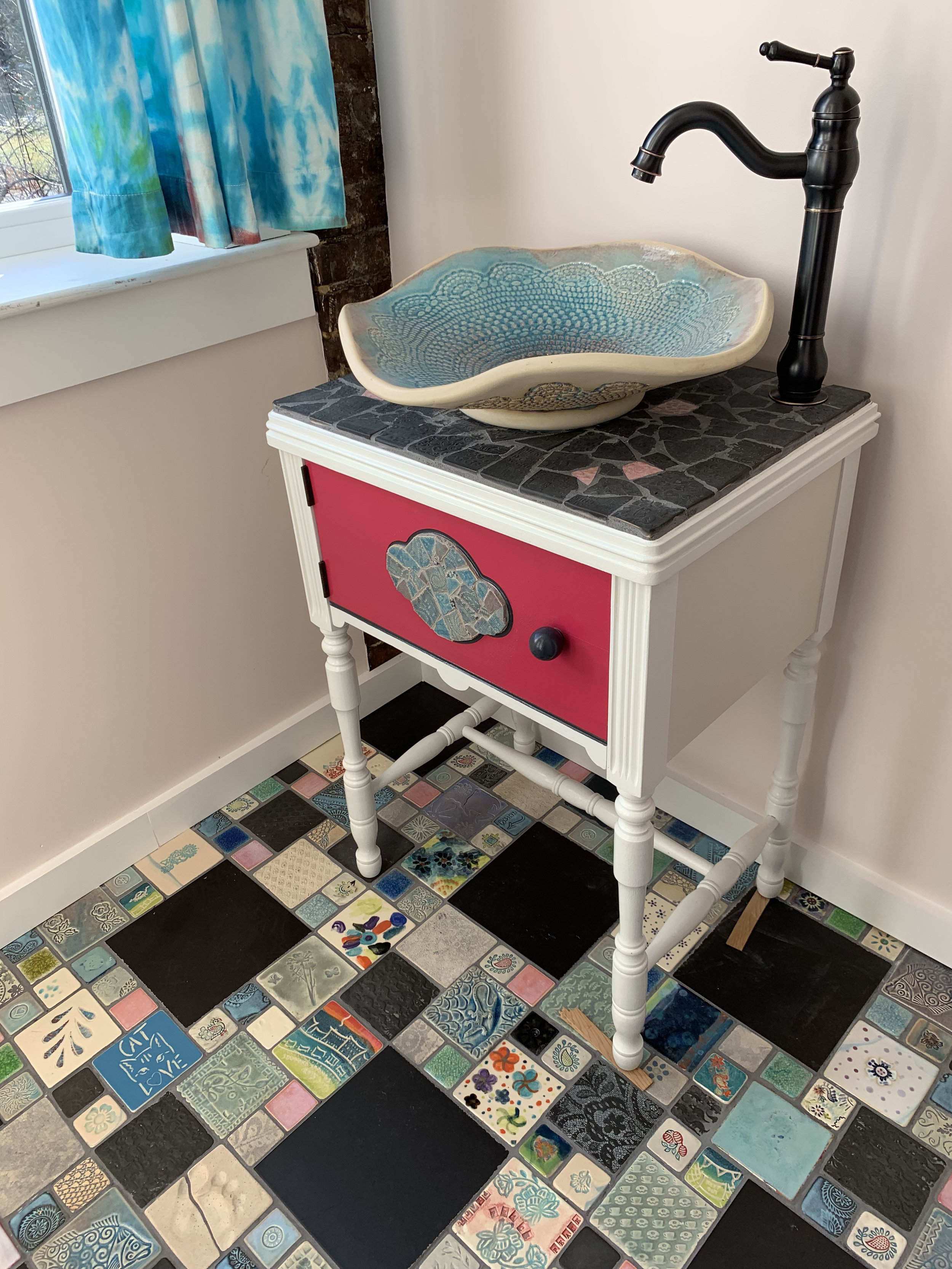 Community Tile floor, a slightly flawed sink, and a sewing machine cabinet made into a vanity