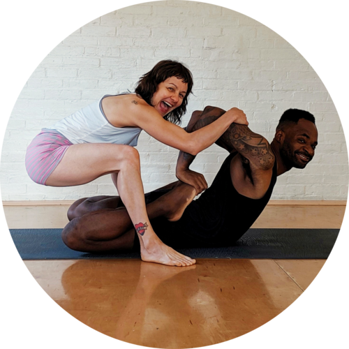 Heather+is+assisting+Justin+in+frog+pose+(bhekasana).png