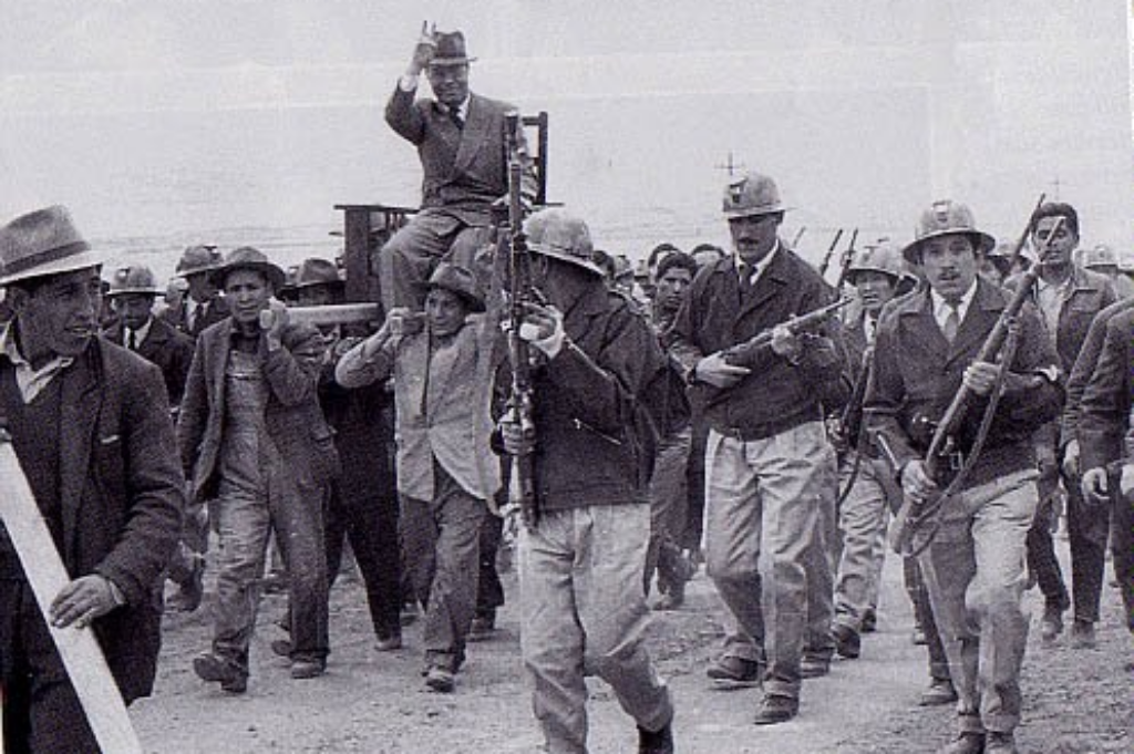 President Paz Estenssoro after signing the decree to nationalize mines in Bolivia. Image Source: Flickr/ 127564046@N02