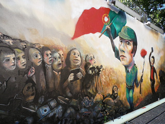 Graffiti representing the Carnation Revolution in Lisbon, Portugal. Image Source: Flickr/jmenj