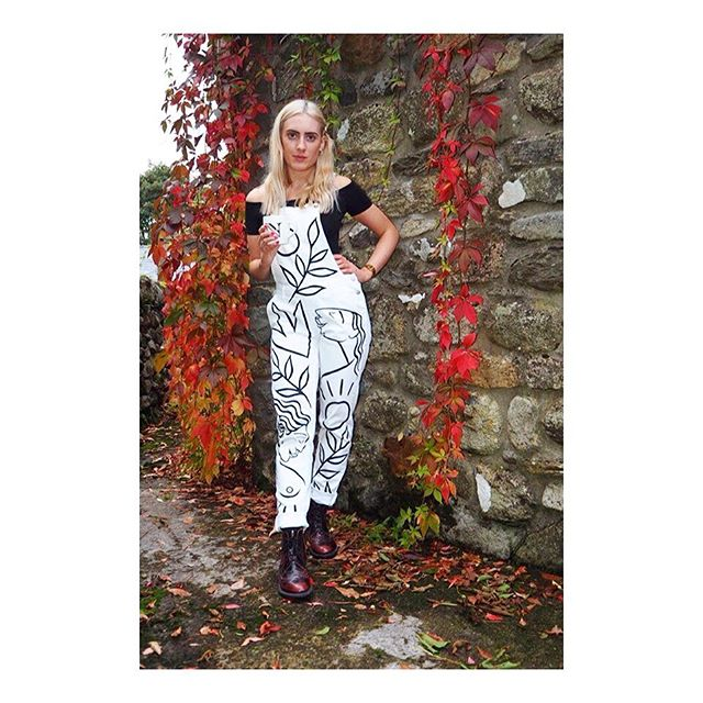 The magnificent @naomisaunders_ proving that white dungarees are not just for summer... HMU to order your own. #sustainablefashion #preloved #handpainted #linedrawing #blackandwhite #ladylove #illustration #whitedenim #ethicalclothing #consciousfashion