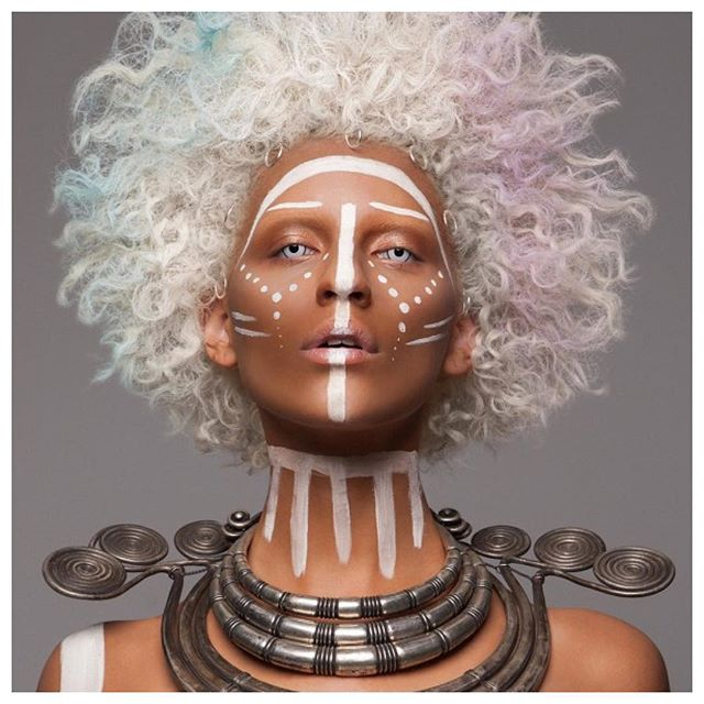 """Face Paint"". Coming into the weekend like a warrior. #makeup #makeupartist #fantasymakeup #african #braids #blackgirlmagic #black #leather #fringe #hairstyles #hair #beauty #tribal #bodypaint #jewelry #necklace #afro #white #curlyhair"