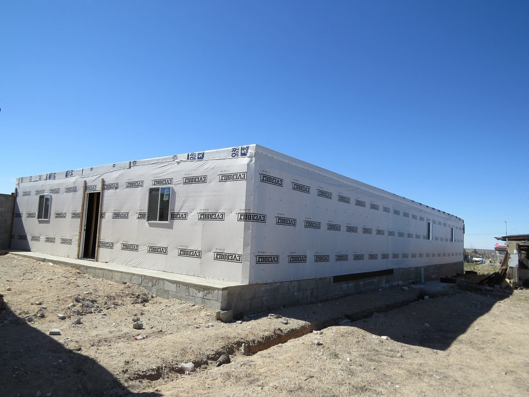 Since last year, Onnemi has continued to work on the building by installing windows, covering the roof and outside against the weather, and installing plumbing.