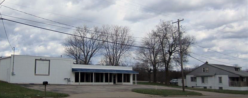A view from SR 59 of the Campbell property; the storefront, left, and house on the right