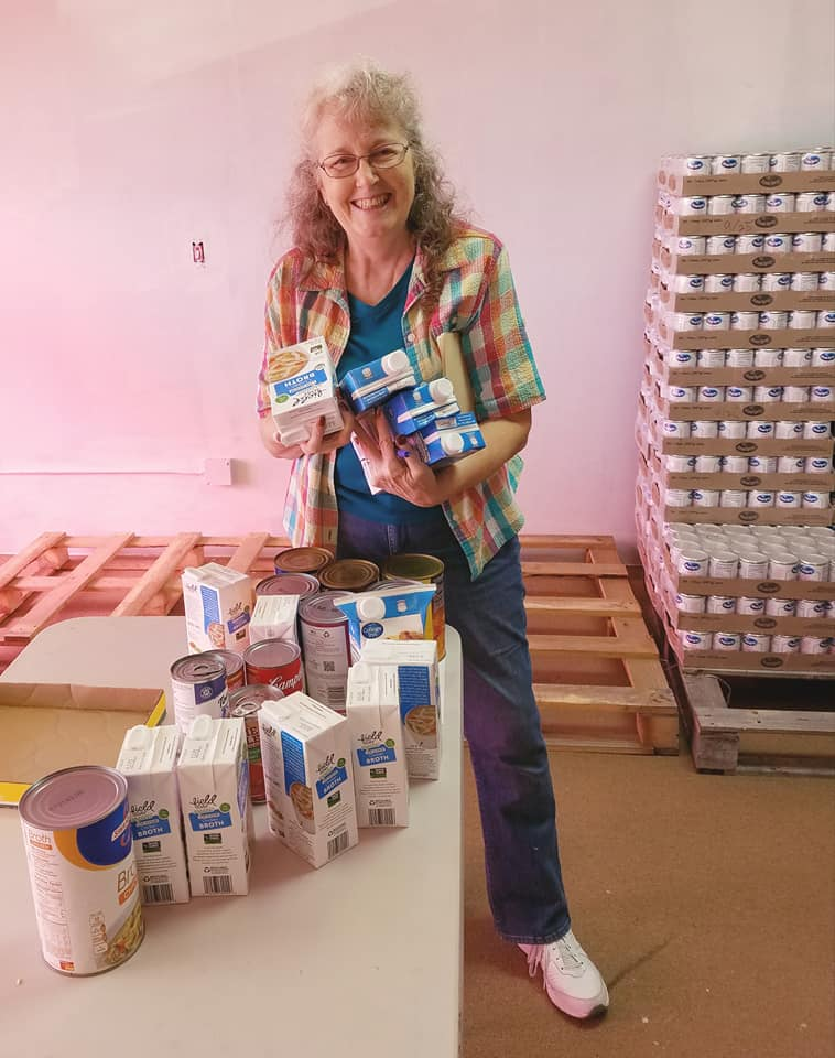 Pat Fuller working at The Haven, sorting food for the Center of Hope's Thanksgiving boxes.